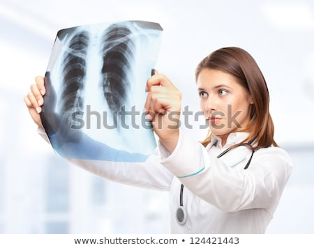 doctor exams a x ray picture stock photo © klinker