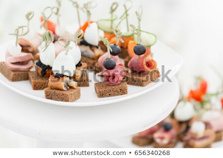 Canape with ham and egg Stock photo © fanfo
