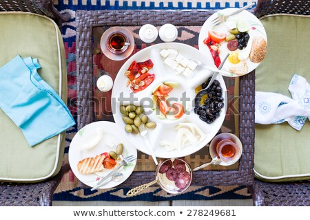 Unfinished Turkish breakfast on a patio table Stock photo © ozgur
