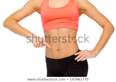 close up of woman pointing finger at her abs Stock photo © dolgachov