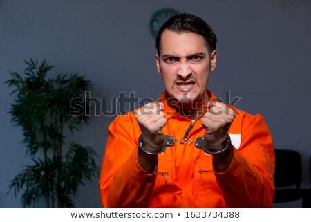 Foto stock: Zangado · prisão · internado · escuro · quarto · homem
