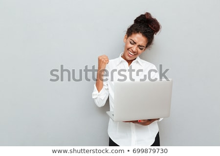 young businesswoman with laptop in arms on white background studio Stock photo © ambro