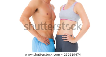 Young woman mid section over white Stock photo © stockyimages