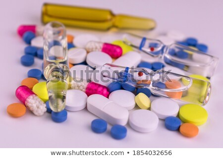 Multicolor tablets with ampoule Stock photo © bdspn