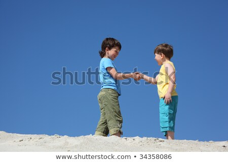 Two boys greet on sand Stock photo © Paha_L