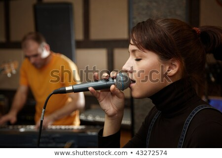keyborder is playing and singing guitar player in out of focus stock photo © paha_l
