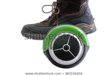 Big boot riding a hover board Stock photo © ozgur