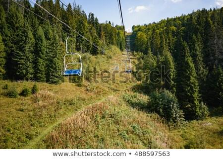 alpesi · lift · hegyek · nő · égbolt · lány - stock fotó © deyangeorgiev