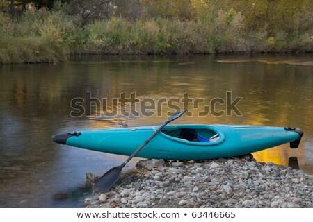 whitewater kayak on rocky shore stock photo © pixelsaway