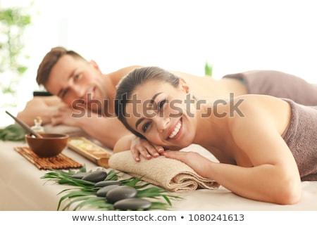 Férfi pihen fürdő szalon napos fektet Stock fotó © Amaviael