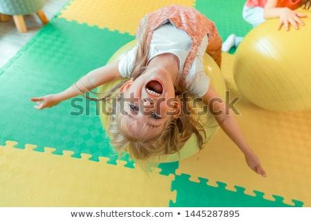 Sportive blonde lies on fitball Stock photo © bezikus