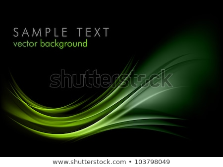 bright green glowing waves on black background stock photo © saicle