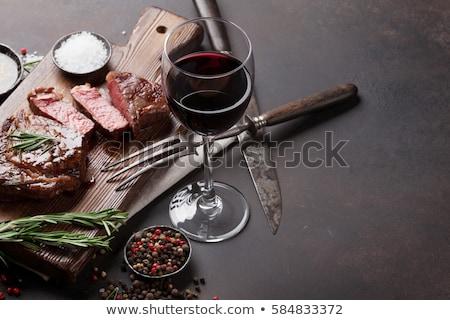 Vinho tinto grelhado bife alecrim sal pimenta Foto stock © karandaev