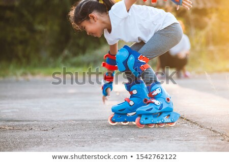 girl roller performs a trick  Stock photo © OleksandrO