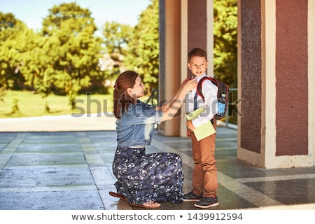 Parents accompany her son to school Stock photo © orensila