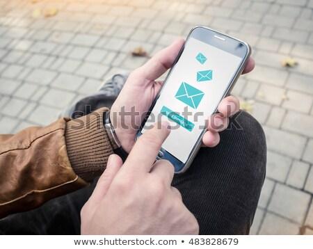 ストックフォト: 若い男 · 送信 · メッセージ · 現代 · スマートフォン