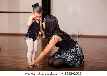 little girl ballerina dancing with her teacher in ballet school stock photo © deandrobot