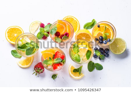 cold summer drink with mint strawberry and lemon stock photo © yatsenko