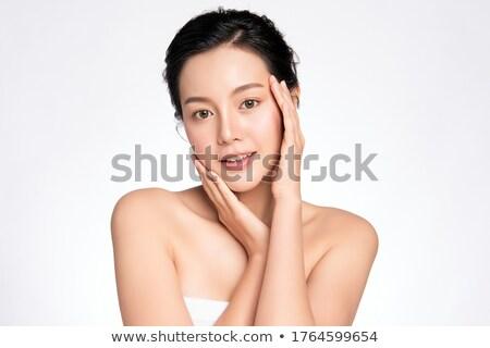 Atraente asiático modelo tocante cara mãos Foto stock © deandrobot