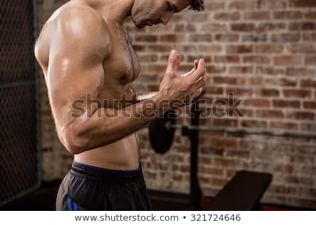 Midsection of man showing abs Stock photo © wavebreak_media