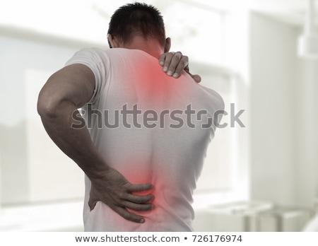 Człowiek cierpienie ból w krzyżu ludzi opieki zdrowotnej Zdjęcia stock © dolgachov