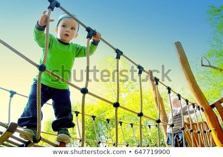 jongen · swing · gelukkig · glimlachend · park · speeltuin - stockfoto © is2