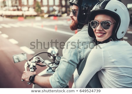 Couple walking with motorcycle helmets Stock photo © IS2