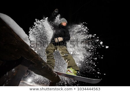 Male riding snowboard Stock photo © IS2