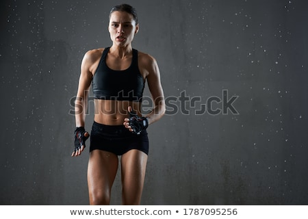 portrait of a concentrated muscular fit sportswoman stock photo © deandrobot
