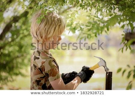 Fiatal srác épület fa fa gyermek jókedv Stock fotó © IS2