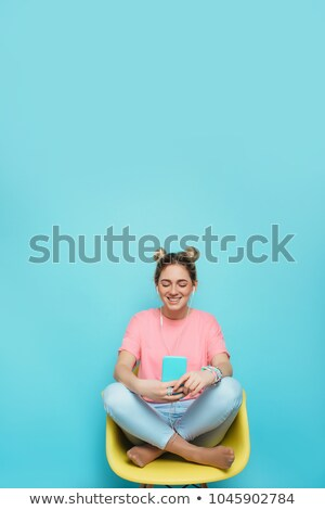 Woman sitting in chair wearing headphones smiling Stock photo © monkey_business