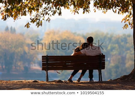 couple on bench hugging Stock photo © IS2