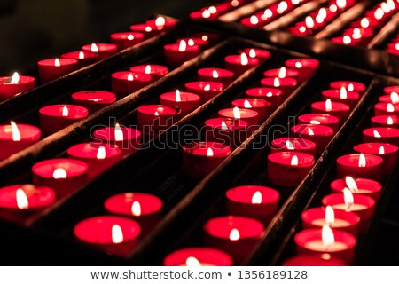 Red candles in a curch Stock photo © stefanoventuri