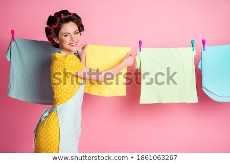 Portré derűs vonzó házvezetőnő egyenruha tart Stock fotó © deandrobot