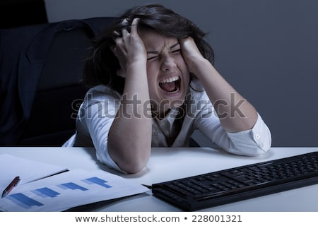 Angry business woman tears her hair out Stock photo © alexanderandariadna
