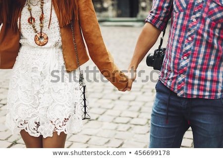 Couple holding hands in old city square Stock photo © IS2
