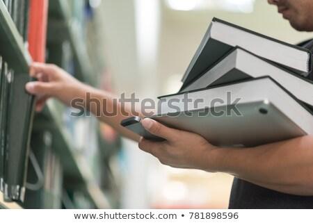 Stock foto: Mann · Auswahl · Buch · Bildung · Bibliothek · College