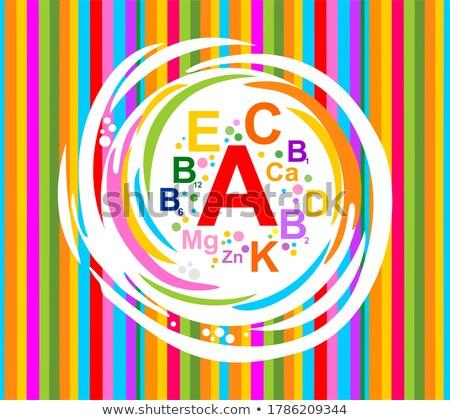витамин капсулы полосы белый фон оранжевый Сток-фото © bdspn