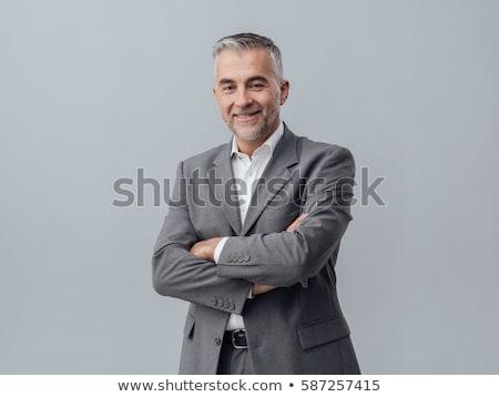 portrait of confident businessman with crossed arms stock photo © kzenon