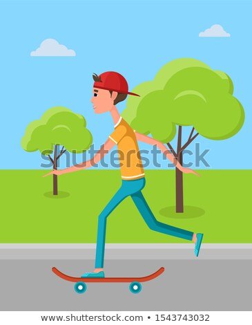 Skateboarder Training in Green Skatepark with Tree Stock photo © robuart