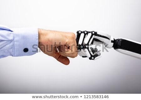 Emberi kéz robot készít ököl dudorodás szürke Stock fotó © AndreyPopov