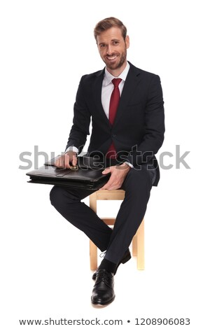 seated businessman waiting for job interview and opening suitcas Stock photo © feedough