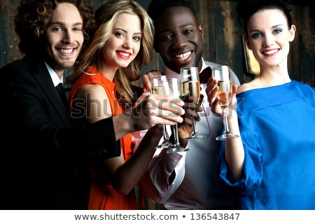 Stock photo: Four beautiful and cheerful women toasting with champagne