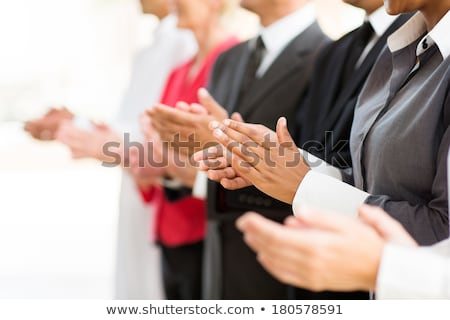 Multiracial young business people  clapping hands in office Stock photo © boggy
