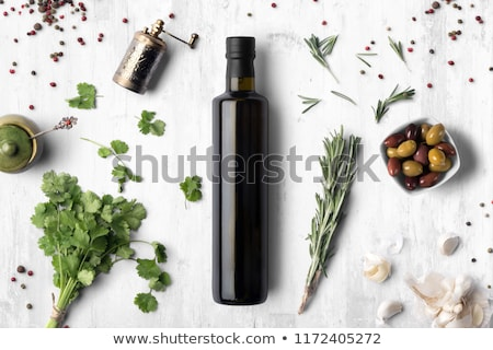 Olive oil and basil Stock photo © YuliyaGontar