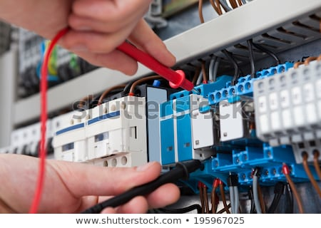 Male Electrician Examining Fuse Box With Multimeter Stock photo © AndreyPopov