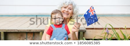 fun loving woman waving proudly the australian flag stock photo © lovleah
