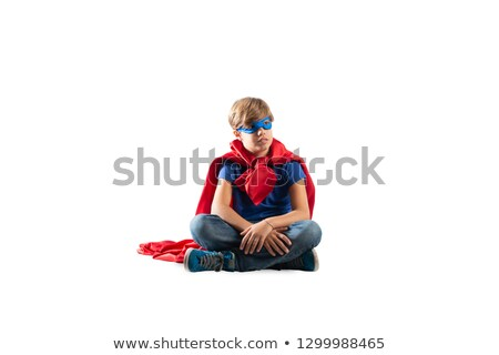 Superhero kid sitting on a wall that dreams. Isolated on white background Stock photo © alphaspirit