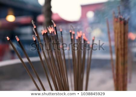 Smell the smoke of Incense, The smoke of joss stick in temple, smoke of incense in the spirit shrine Stock photo © galitskaya