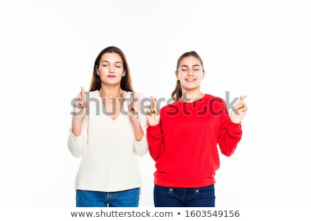 Kettő lányok visel pizsama izolált szürke Stock fotó © deandrobot